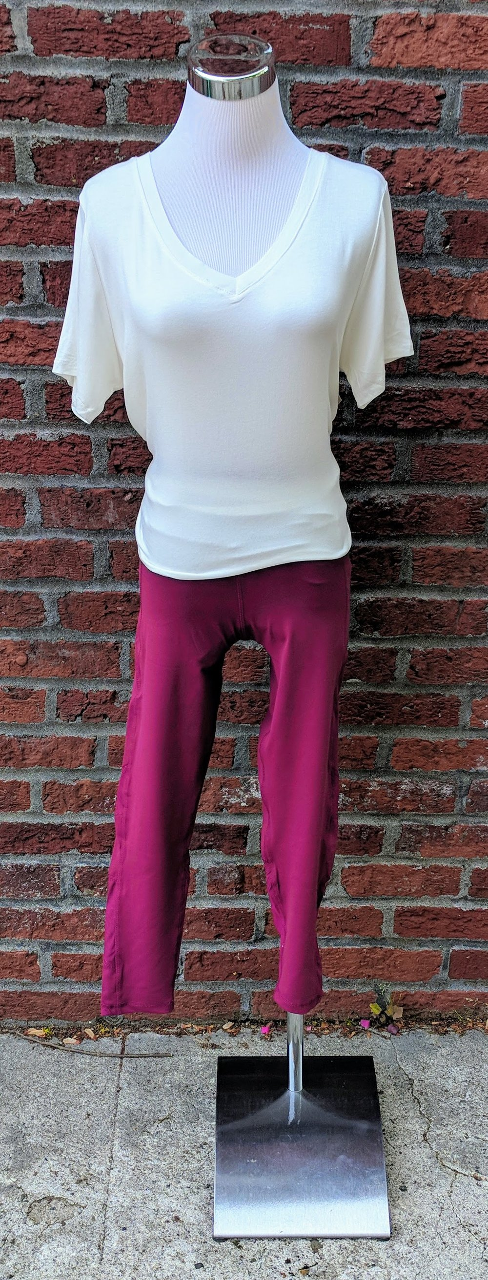 Deep plum leggings with mess accent on back of calves.