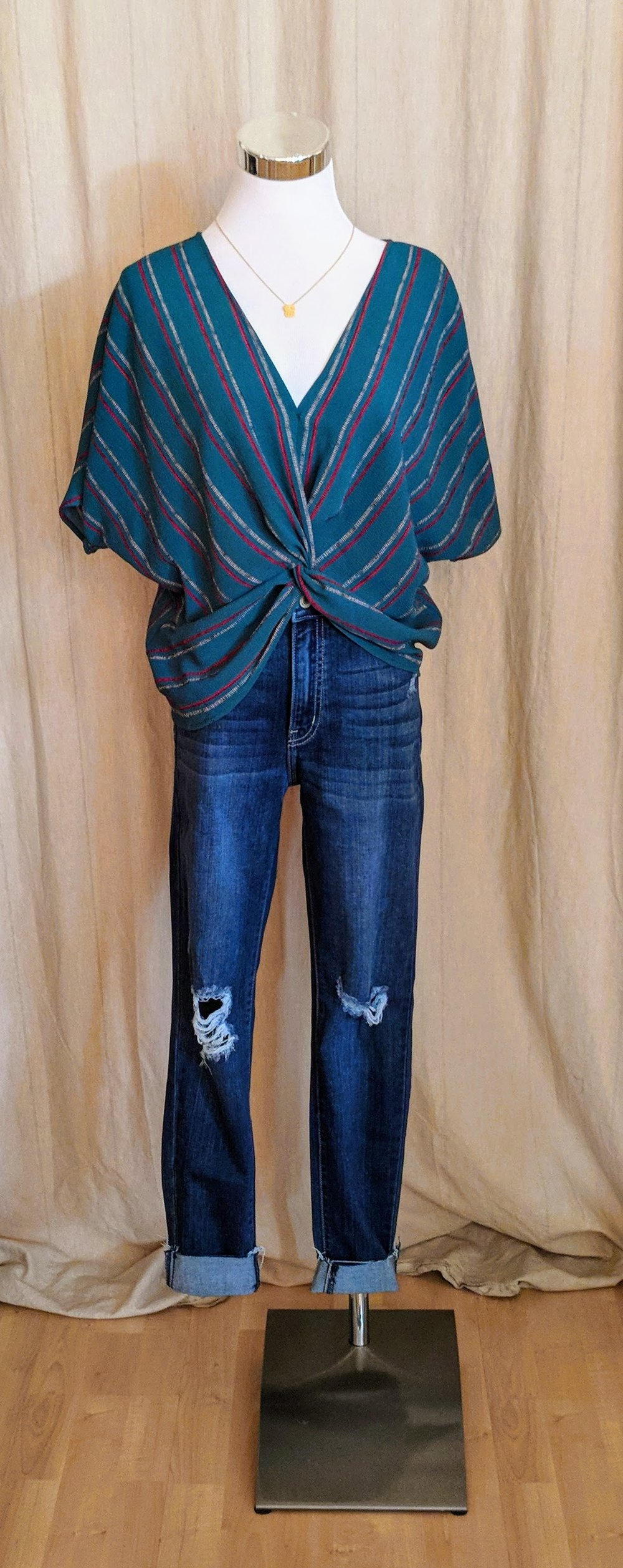 Teal Green stripe twist front top with high low hem.