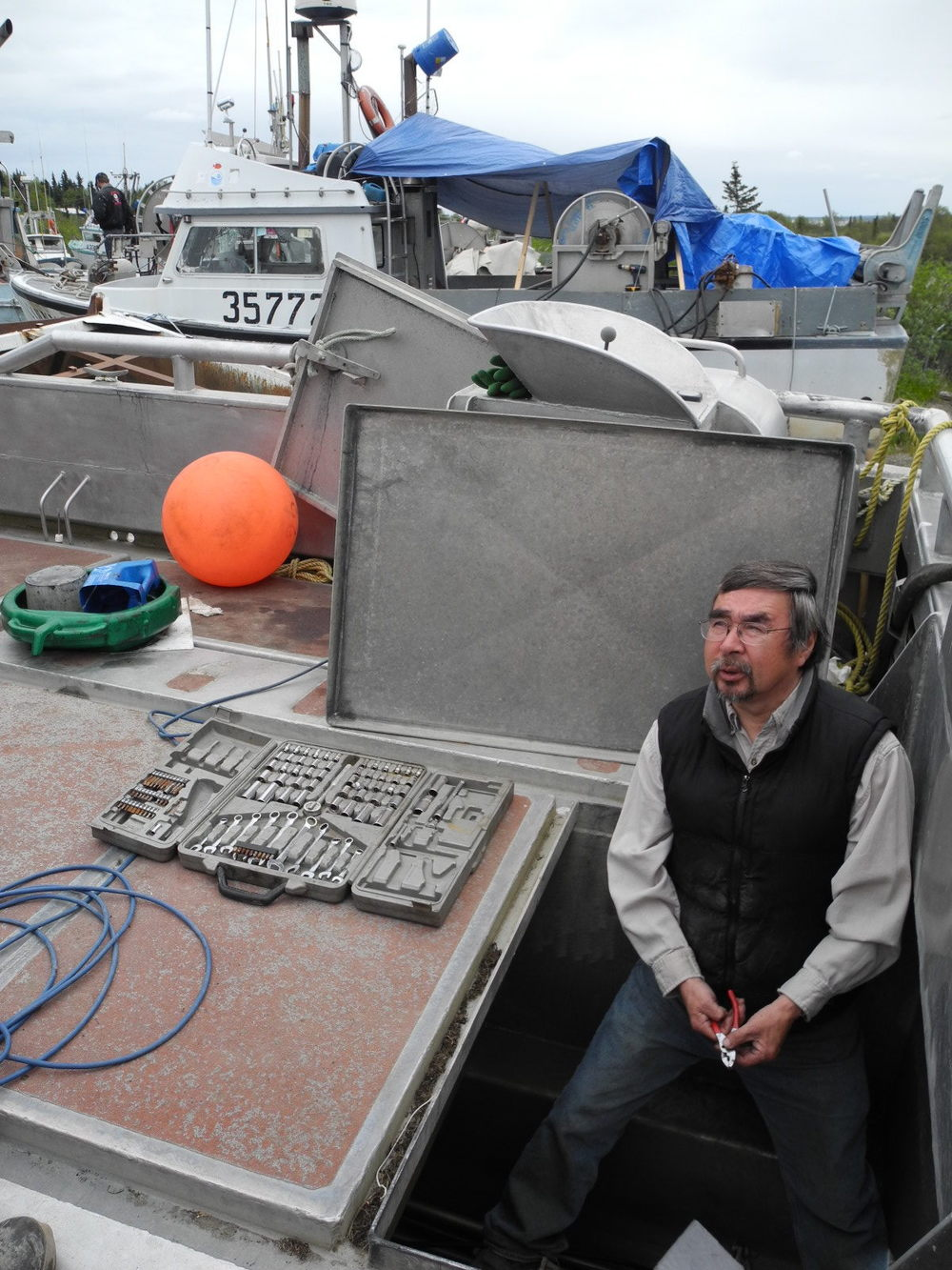 Chief Tom Tilden works on his fishing boat in Dillingham, Alaska