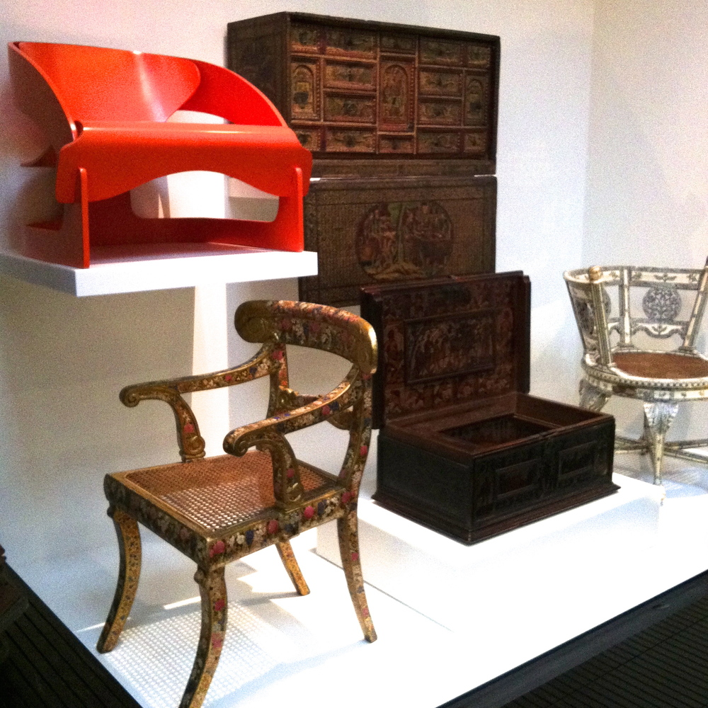 Decorative 19th Century armchair from India sits beneath Joe Columbo's 1963 Armchair