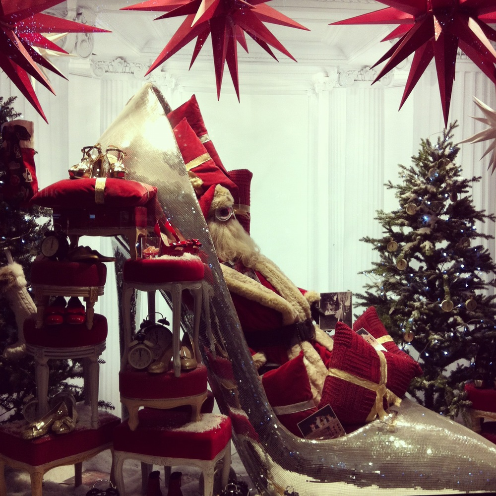 Santa caught napping in the  Selfridges  Christmas windows on Oxford Street ahead of his big week.