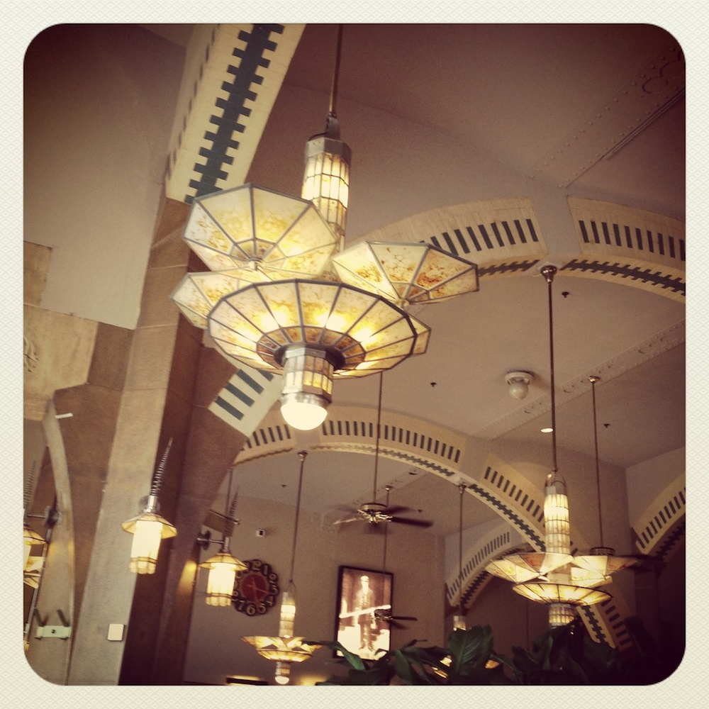 Stunning lights in the historic and cavernous Cafe Americain where we stopped for a coffee.