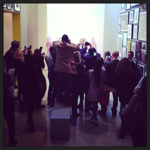 Paul Smith faces a scrum of photographers at the opening of his exhibition 'Hello, My Name Is Paul Smith' at the Design Museum in London yesterday