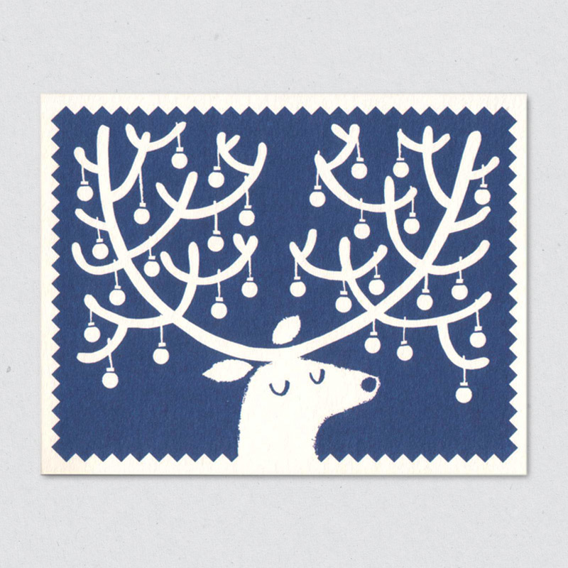 A bauble-festooned reindeer by  Lisa Jones Studio
