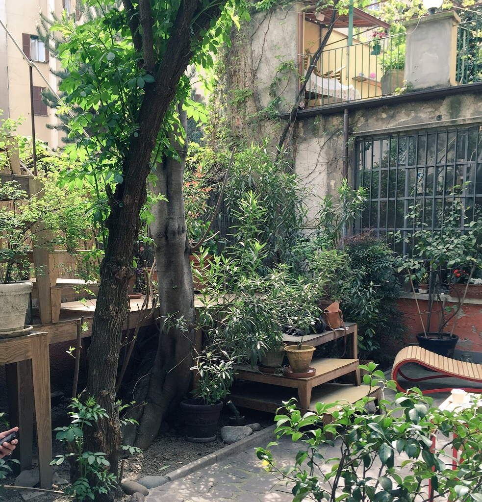 Check out their courtyard. With a curvy piece of furniture from Paracastello to the right, by Jono Nussbaum.
