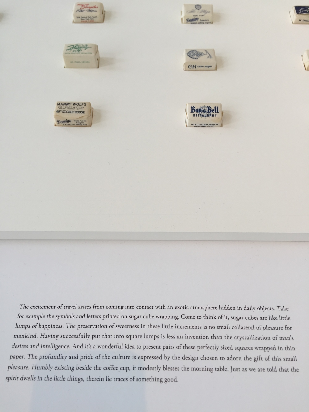 "Fantastic quote about travel from the Takeo Paper Show expressed through paper-wrapped sugar cubes:  ""The excitement of travel arises from coming into contact with an exotic atmosphere hidden in daily objects"" . Explains my love of foreign supermarkets."