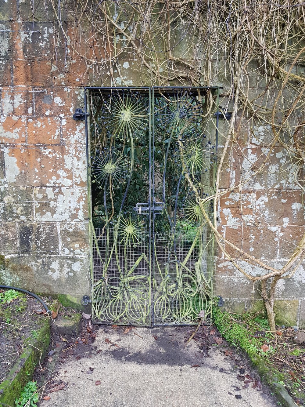 The Allium gate in the walled kitchen garden at Gravetye Manor