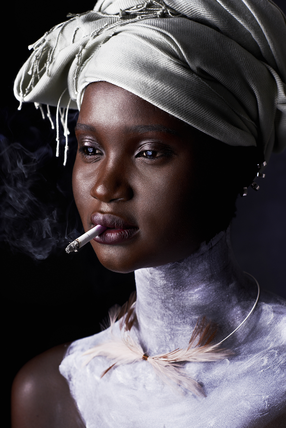 GARAGE MAGAZINE. ATAUI DENG WEARING SIMON ALCANTARA STERLING SILVER WIRE CHOKER HAND WOVEN WITH CHAMPAGNE FEATHERS $295.00 TO PURCHASE PLEASE  USE THE Contact Us PAGE.