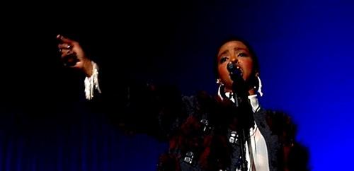Miss Lauryn Hill wearing Comsmic Samurai bracelet and earrings in concert