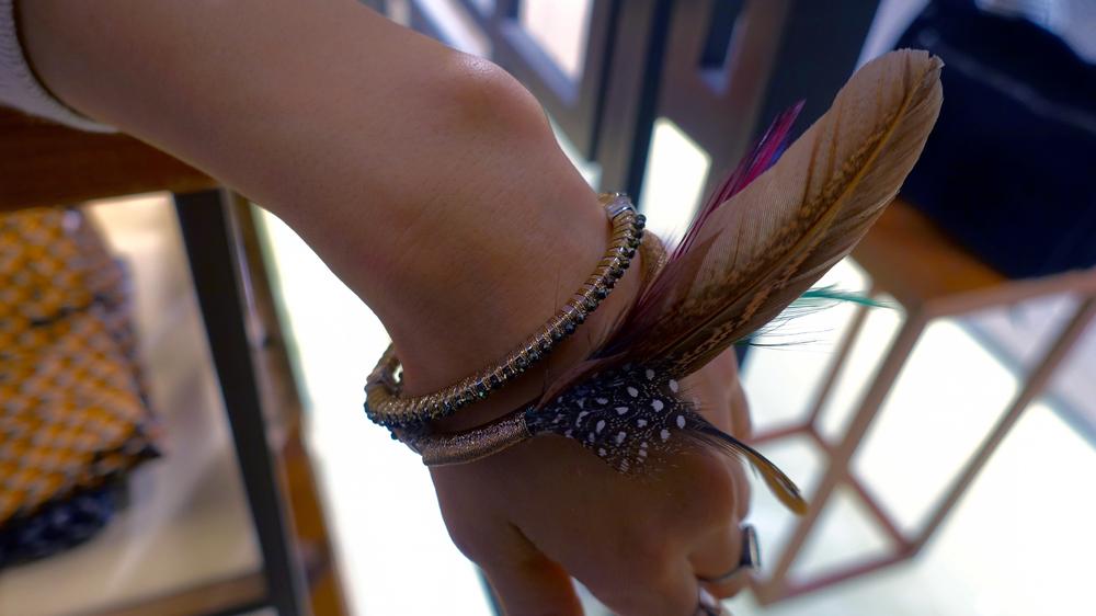 SIMON ALCANTARA SPINEL AND FEATHER BRACELETS.jpg