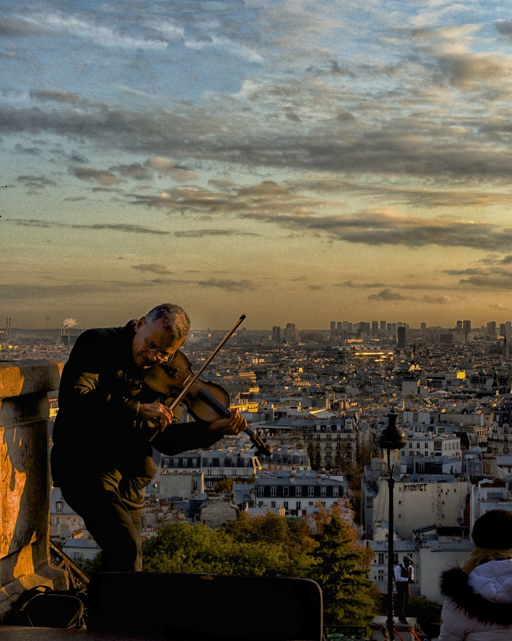 violin player looking over paris from montmarte.jpg