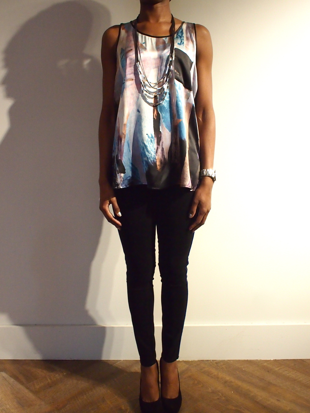 Silk printed tank by Tiger Of Sweden $199 paired with Black Waxed Skinny Jeans by J Brand $245