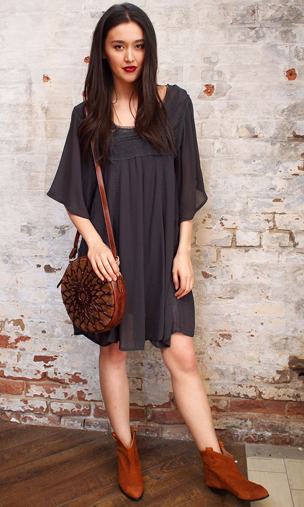 Ganni Dress $150, Jenny Bird canteen bag $245, Ganni boot $324
