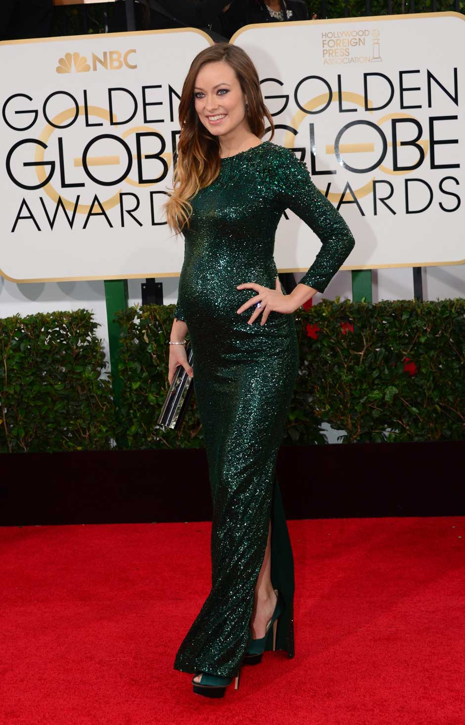 Mom to be Olivia Wilde was glowing in this gorgeous emerald green sequin gown from Gucci.
