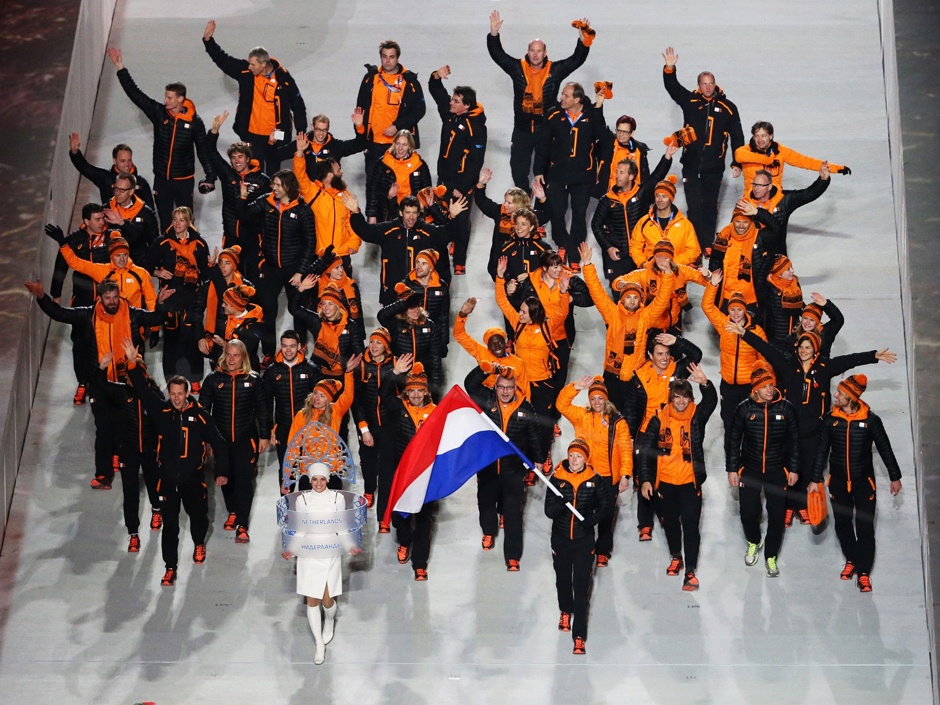 The Dutch team stand out in their high gloss reversible puffers showing the world that orange and black is the new black.