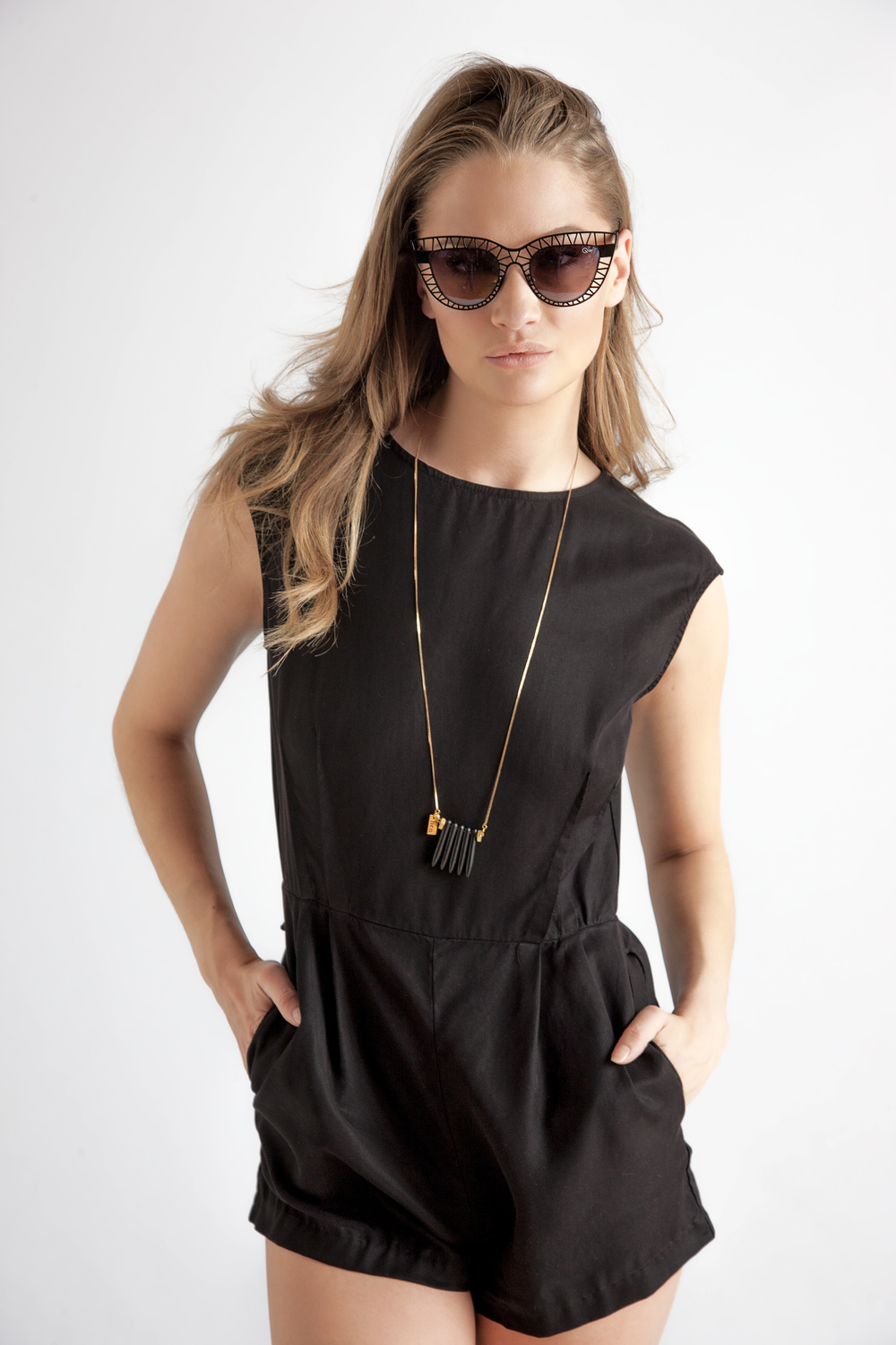 Short Romper by Sam & Lavi $198 | Sunglasses by Quay $55 | Necklace by Hen $49