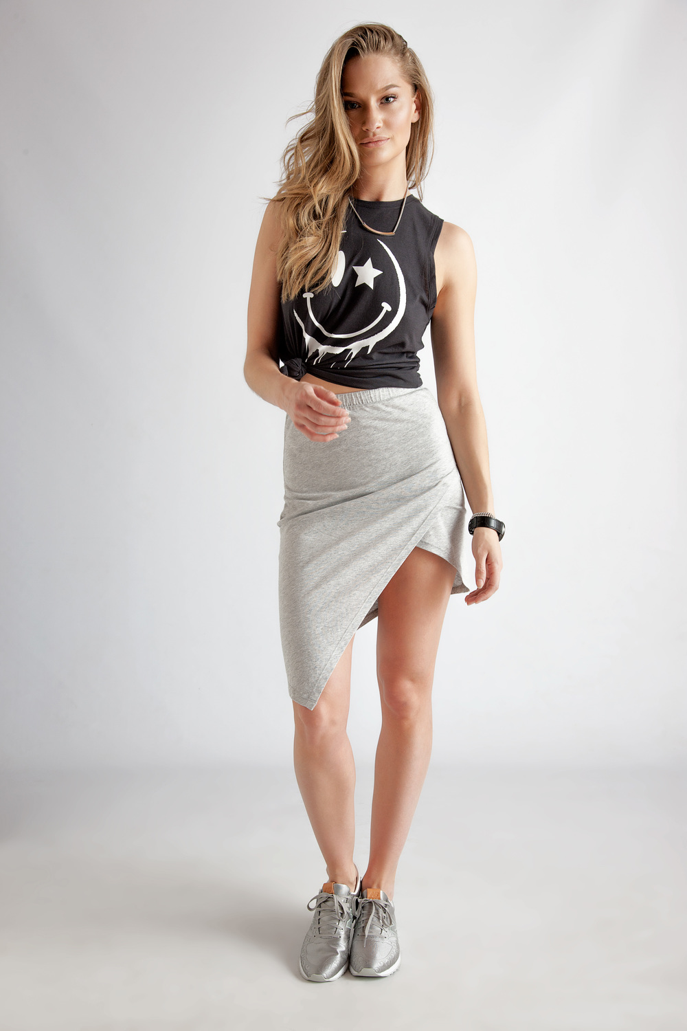Tank by South Parade $80 | Skirt by Alternative Apparel $93 | Necklace by Liel & Lentz $100 | Sneakers by New Balance $110