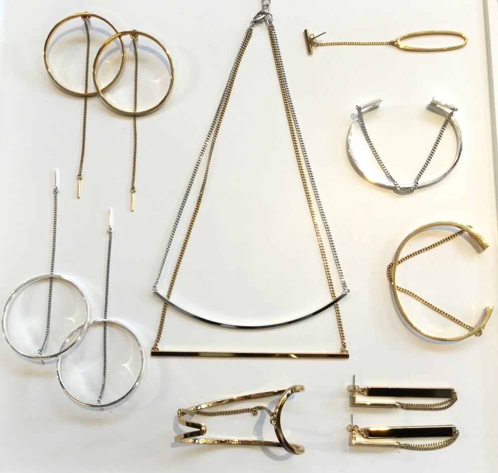 By now we all know it's ok to mix and match our metals, but there are few who do it as well as Jenny Bird. In her latest collection she plays with 14k gold, sterling silver and rose gold dipped brass to create her shiny new statement pieces. Rhine Hoops $75, Tula Swing $95, River Cuff $95, Ear Slant Cuff $70, Mia Cuff $85, Zenith Earrings $70