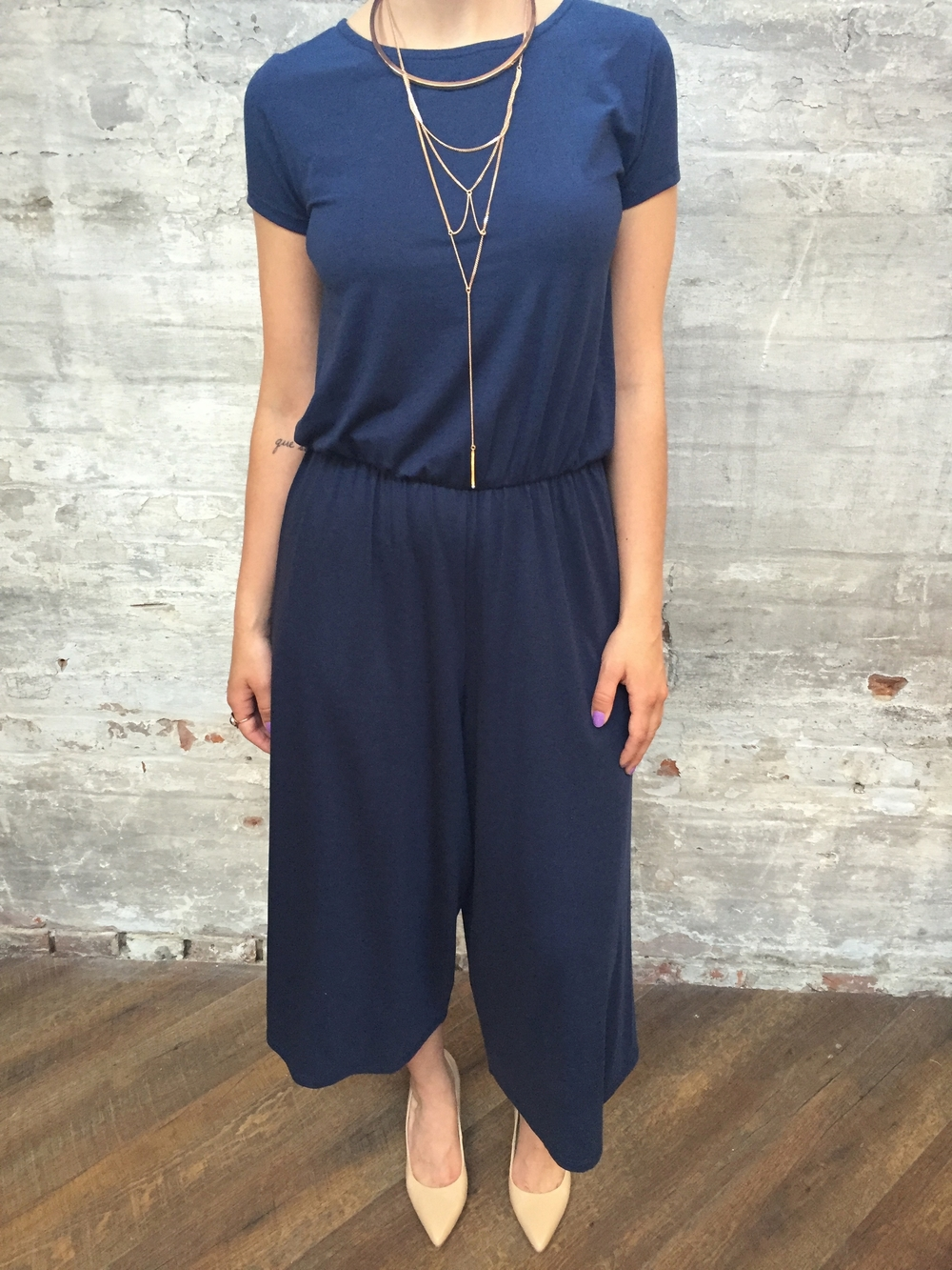 American Vintage Cropped Jumpsuit $198 Jenny Bird Neith Necklace $140 Tiger of Sweden Leather Pumps $249