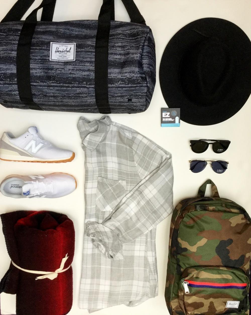 Herschel Sutton Bag $65   Brixton Hat $80   New Balance Retro Runners $130   Le Specs Sunglasses $110   Rails Plaid Shirt $215   Woolrich Blanket $120   Herschel Backpack $80