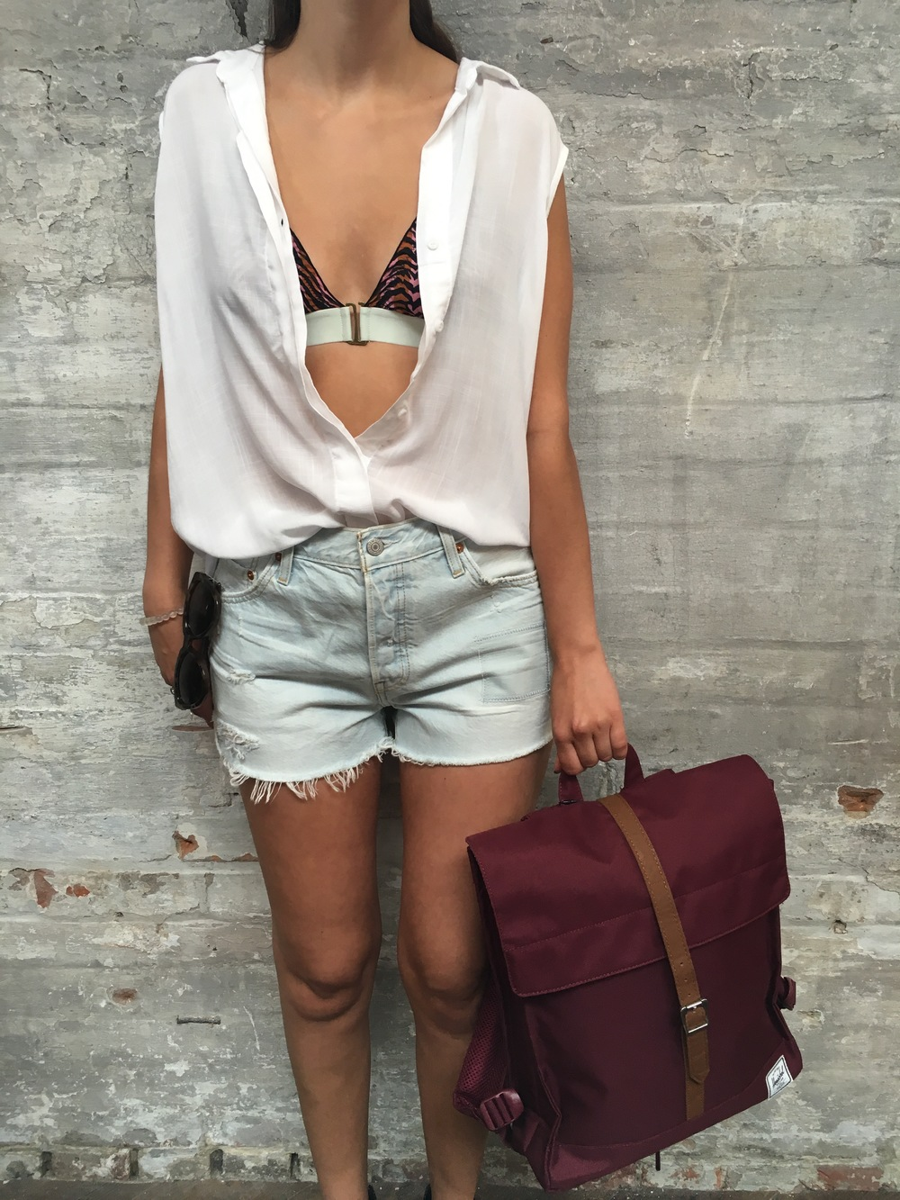 Love Stories Bathing Suit Top $110 & Bottom $75 Bella Dahl Sleeveless Crosshatch blouse $150 Levi's Shorts $69 Herschel City Backpack $60 Le Specs Sunglasses $118