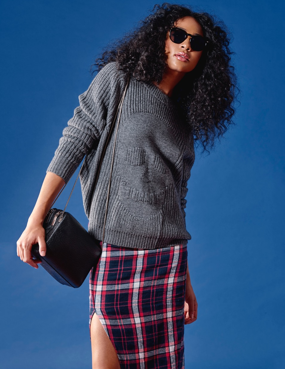 Pair chunky knits with sleek skirts for the perfect Fall look. This edgy combination has street style star written all over it Autumn Cashmere Skull Sweater $395 Nana Judy Plaid Skirt $95 Naked Vice Leather Bag $250