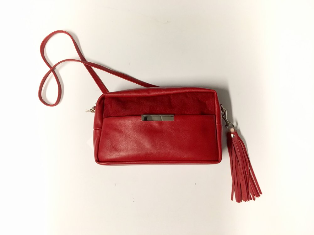 Close Up: Opelle is a Toronto based bag brand that you need to check out. The Issa cross body bag comes in this red, a forest green and a classic black. $325