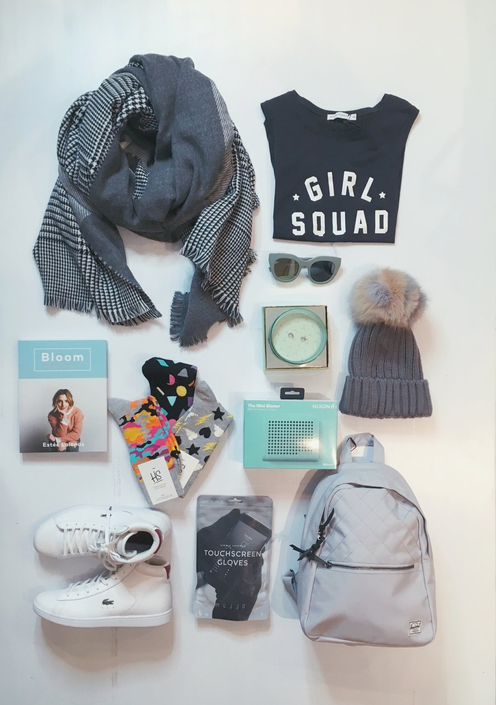 When they probably own everything but it's time for an upgrade... Featured: (left to right) Fraanklin Reversible Scarf $105 | Girl Squad Tee $66 | Le Specs $110 | Bloom Book by Estee Lalonde $28 | Happy Socks $15 | Nixon Mini Blaster $110 | Odeme Candle $69 | Multicoloured Fur Pom Toque $125 | Lacoste Carnaby Sneakers $195| Mujjo Tech Gloves $49 | Herschel Town Backpack $64