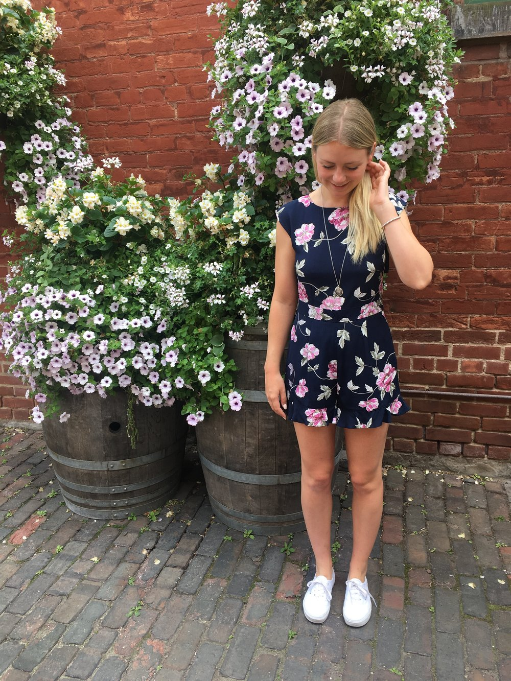 A floral romper paired back to white vans is the ultimate summer look - Cupcakes & Cashmere romper $175Vans Authentic Classic $100