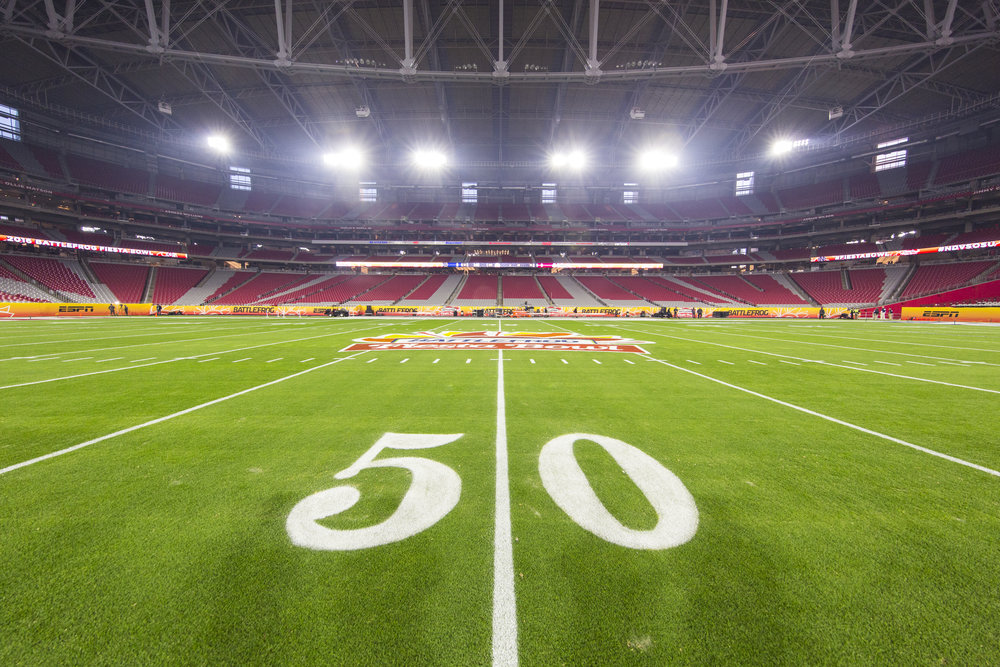 Will the Huskies be playing in Glendale on New Year's Eve? (Rick Tapia/AP)