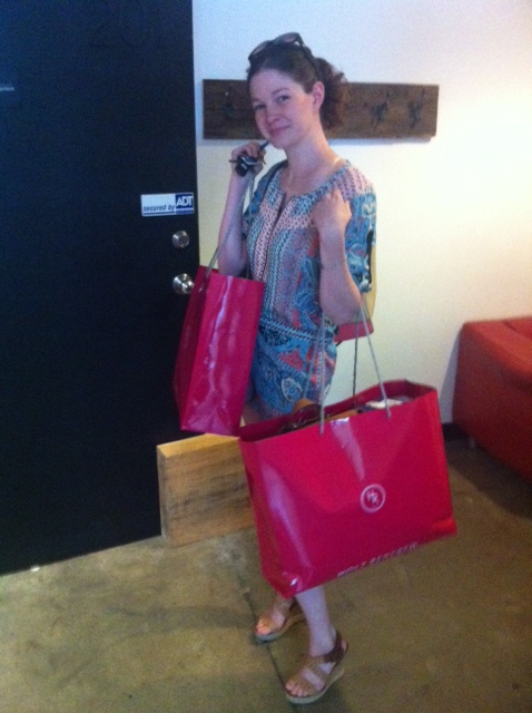 Megan doing some heavy lifting bringing back all of our Holts goodies!