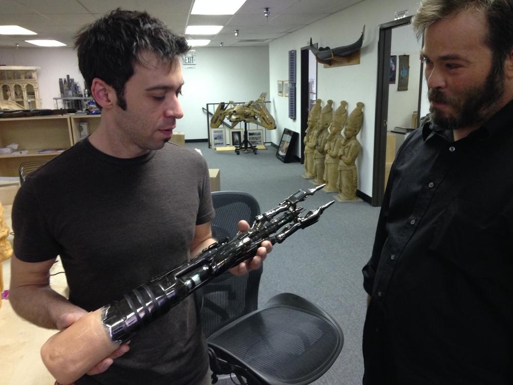 Chris Vaughan shows off the Terminator T-X arm at Stan Winston Studios.