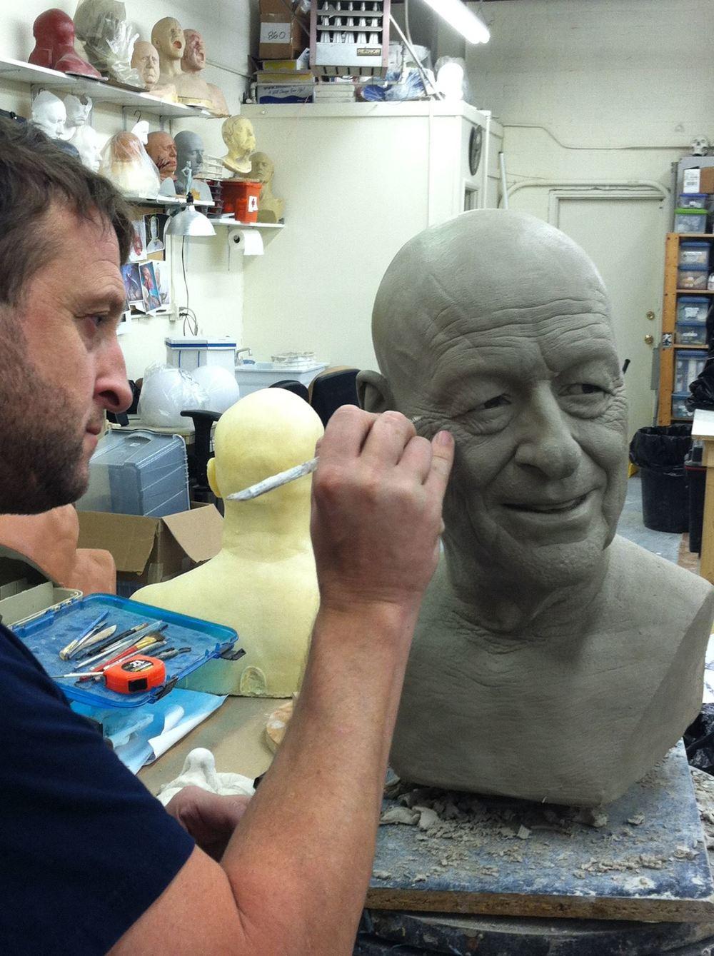 Mike Hill sculpting Ray Harryhausen's portrait