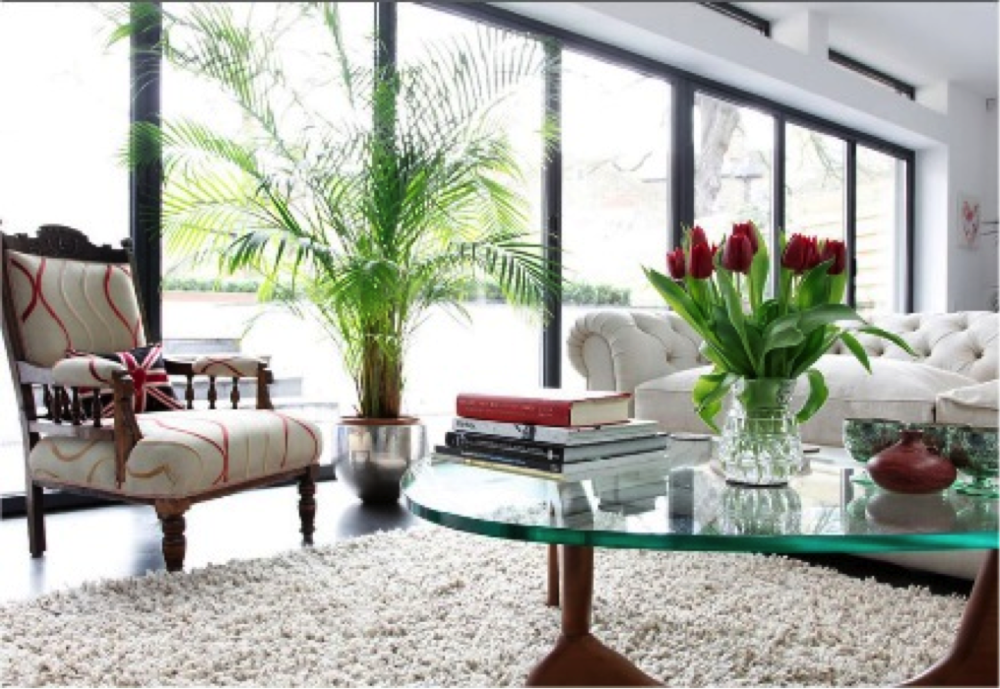 Spring Renew - unclutter the coffee table via Elite Homes