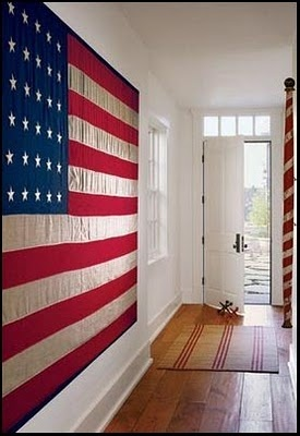 Add a flag to your wall - its easy and quick to hang and makes a bold 4th of July statement.