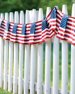 Flag bunting on the picket fence by Martha Stewart