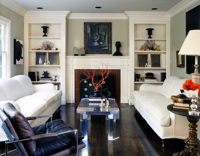 Modern leather chair flanks a traditional room