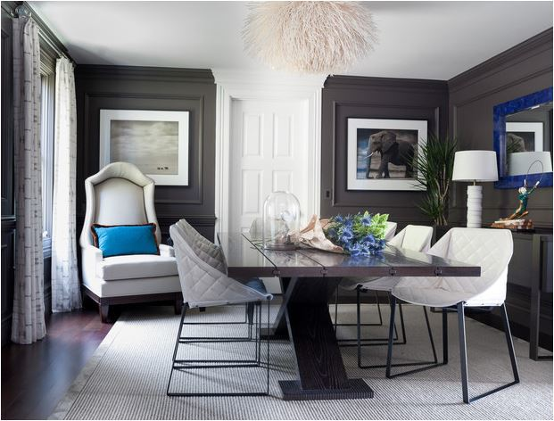 Graphic grey hues create a dramatic chic, more formal atmosphere; but with eclectic furnishings, a modern style emerges via Green Couch Interior Design