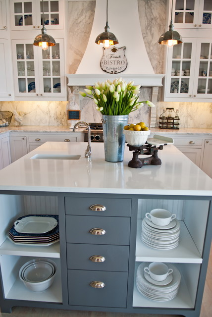 Grey Island offsets a white kitchen - via Kristi Spouse Interiors