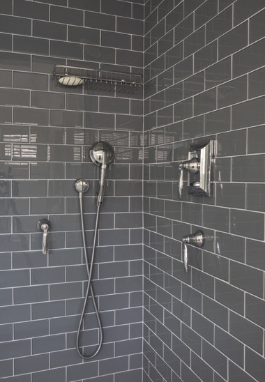 Grey high gloss subway tile in Master Shower via Niche Interiors