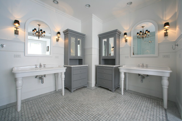 Classic grey and white tile floor with grey his and her cabinets via Zinn Design