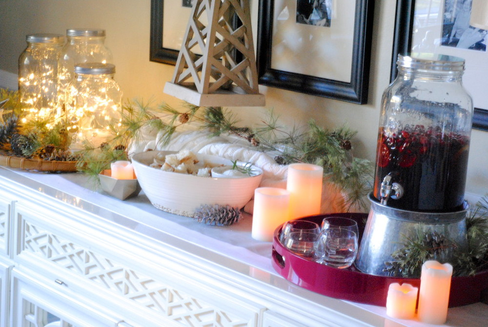 Love this Christmas buffet from makinglemonadeblog.com.  Cranberries in glass beverage dispenser bring in the color of the season.