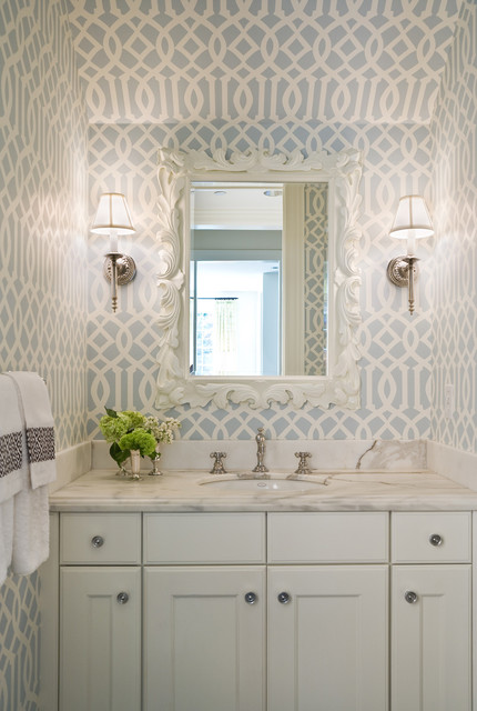 Bold design wallpaper can make a small space look larger and chic.  Via GR Interiors.