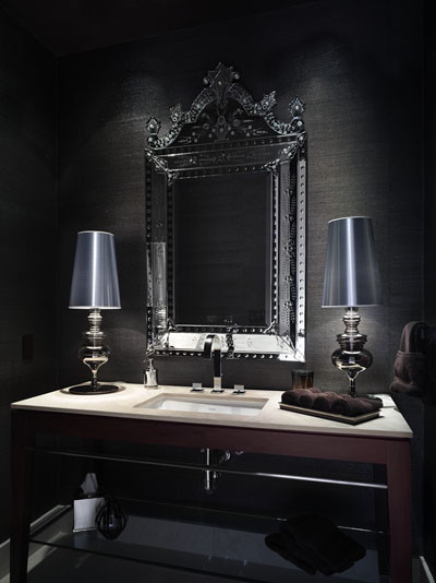 Dark and mysterious powder rooms create an ambiance of those romantic and glamorous days of the silver screen.  Via Habachy Designs.