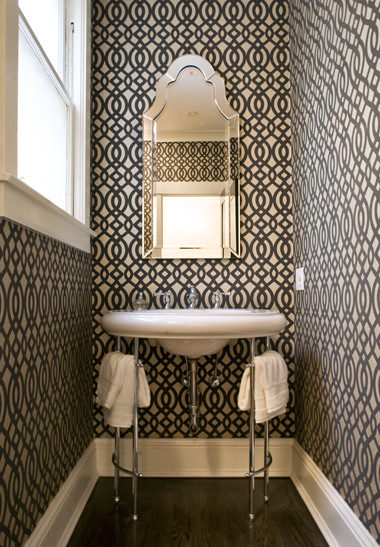 The best place to use bold wallpaper designs is in the powder room.  Via Niche Interiors.
