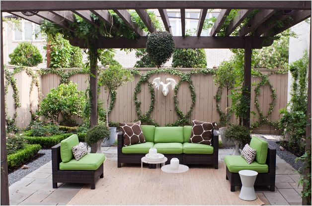 Touches of bright modern cushions and a natural outdoor rug effortlessly blend into nature's backdrop.