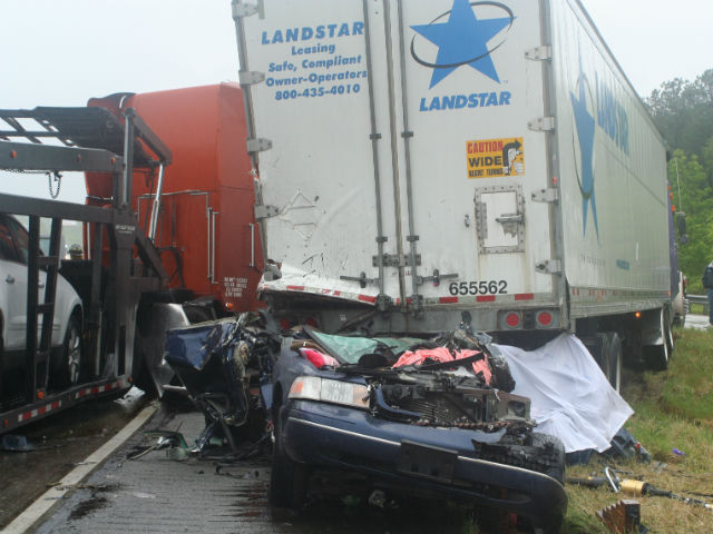 The remains of the Crown Victoria Sam's mother was driving the day she was rear-ended by a semi trailer, hit again & spun and then driven underneath another semi truck. All four people in the car had to be removed with the Jaws of Life.