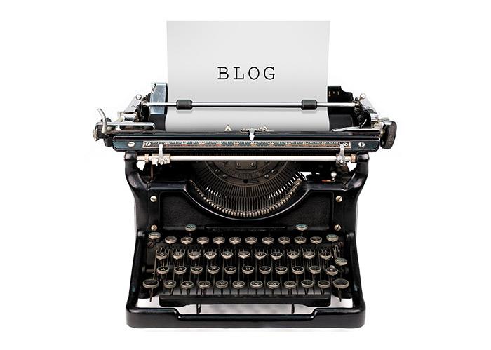 Typewriter containing the word 'blog'.