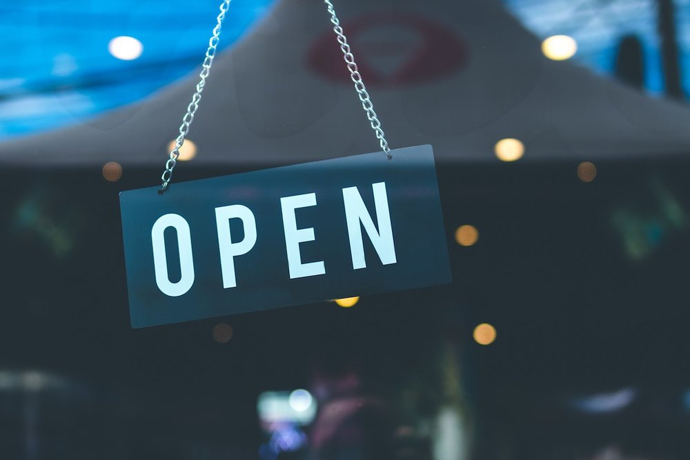 How to buy Shopify stores with Shopify Exchange — image of a store with an 'open' sign on the door
