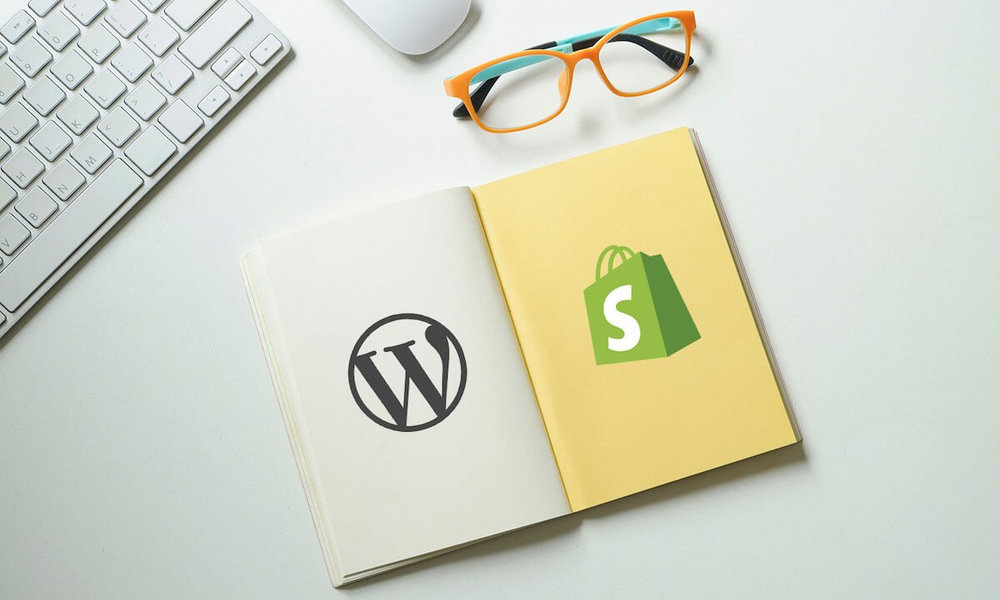 d7eccd7a27c7 Shopify vs Wordpress Comparison. Image featuring the Wordpress and Shopify  logos in a notepad.
